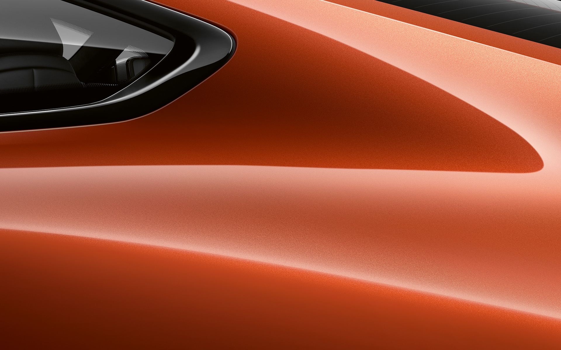 Close-up of the C pillar of the BMW 8 Series Coupé in Sunset Orange metallic.