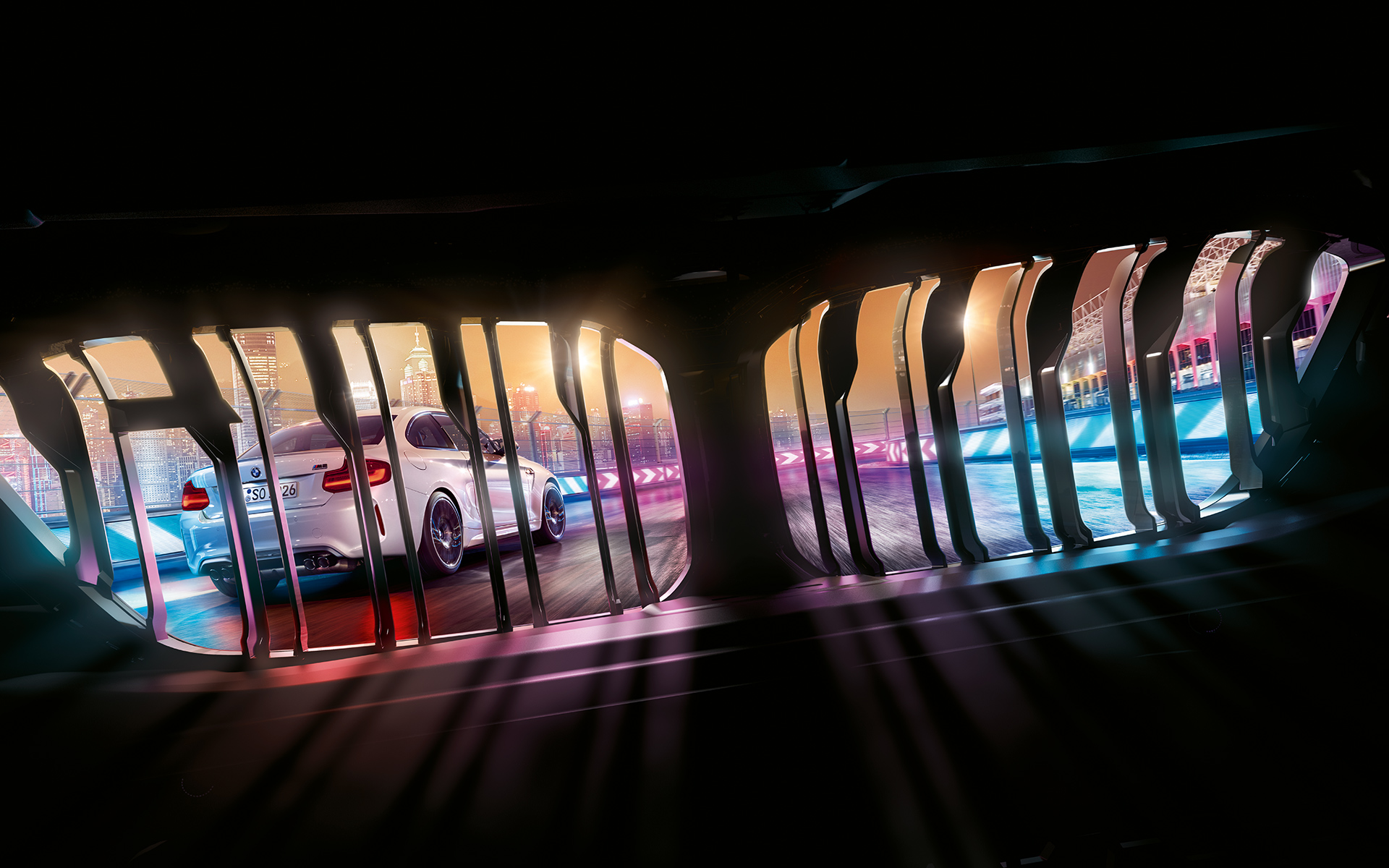 View through BMW kidney on preceding BMW M2 Competition on nocturnal race track.
