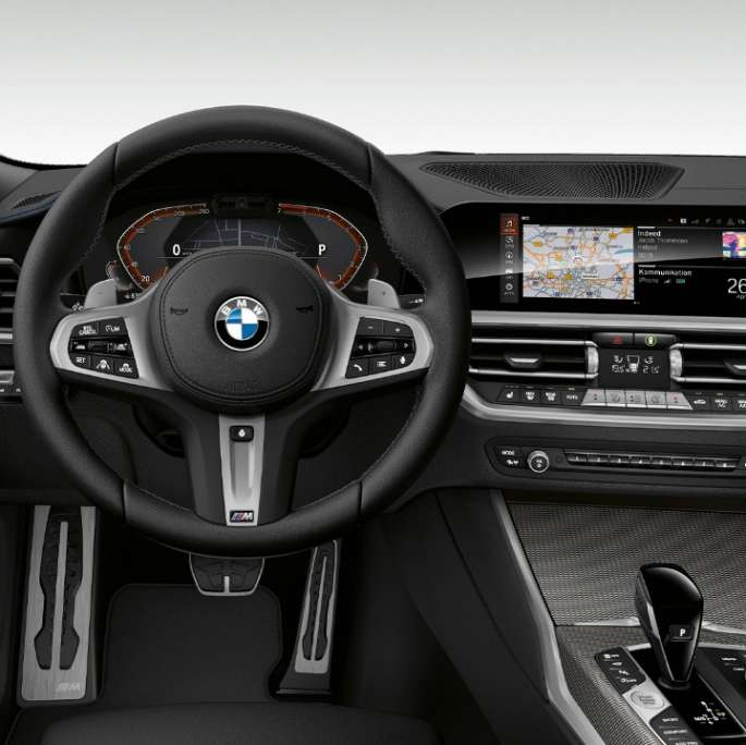 Frontal close-up of the driver's cockpit of the BMW 3 Series Sedan with Model M Sport features.